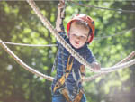 View larger image of Young boy on a zip line at WILDERNESS PRESIDENTIAL RESORT image #3
