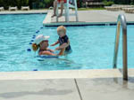 View larger image of Mother and child in the pool at WILDERNESS PRESIDENTIAL RESORT image #4