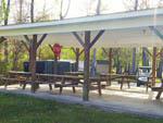 View larger image of Patio area with seating at HAWKINS CREEK CAMPGROUND image #3