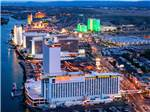 View larger image of An aerial view of the casinos along the river at dusk at VISIT LAUGHLIN image #1