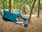 View larger image of Kids relaxing at campsite at GEORGIA STATE PARKS  HISTORIC SITES image #3