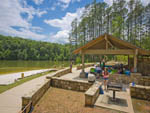 View larger image of Patio area with picnic tables at GEORGIA STATE PARKS  HISTORIC SITES image #11