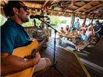 View larger image of A man playing a guitar in front of people at BIG PINE KEY  FLORIDAS LOWER KEYS image #7