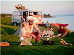 View larger image of Family roasting marshmallows at PEI PROVINCIAL PARKS image #1