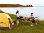 View larger image of Playing guitar at waterfront at PEI PROVINCIAL PARKS image #2