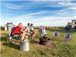 View larger image of Roasting marshmallows near the waterfront at PEI PROVINCIAL PARKS image #3