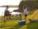 View larger image of Couple camping in tent along the ocean at PEI PROVINCIAL PARKS image #6