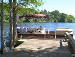 View larger image of Boat docked on lake at CYPRESS CAMPING RESORT image #1