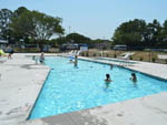 View larger image of People swimming in pool at CYPRESS CAMPING RESORT image #2
