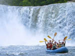 View larger image of Family rafting at FALLS CREEK CABINS  CAMPGROUND image #1