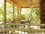 View larger image of Patio area with seating at FALLS CREEK CABINS  CAMPGROUND image #3