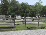 View larger image of An empty grassy RV site at FALLS CREEK CABINS  CAMPGROUND image #5