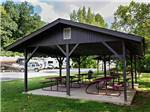 View larger image of Patio area with picnic tables at BLOWING SPRINGS RV PARK image #2