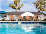 View larger image of Swimming pool with outdoor seating at VINES RV RESORT image #6