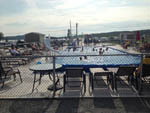 View larger image of Swimming pool with outdoor seating at KOA BAS-ST-LAURENT CAMPGROUND image #5