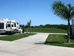 View larger image of Trailer camping at campsite at TEXAS LAKESIDE RV RESORT image #2
