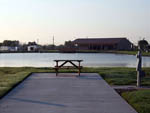 View larger image of Picnic table with lake view at TEXAS LAKESIDE RV RESORT image #8