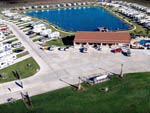 View larger image of An aerial view of the main building and lake at TEXAS LAKESIDE RV RESORT image #9