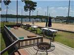 View larger image of The cornhole court with a fire pit at BAREFOOT BAY MARINA AND RESORT image #8