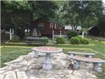 View larger image of Outdoor table and chairs in grassy area at SHREVEPORTBOSSIER KOA image #2