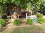 View larger image of Playhouse and picnic table next to a cabin at SHREVEPORTBOSSIER KOA image #5
