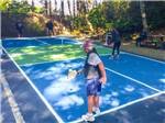 View larger image of 4 people playing pickleball at PACIFIC SHORES MOTORCOACH RESORT image #10
