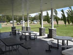 View larger image of Patio area with outdoor seating at DIAMOND GROVE RV CAMPGROUND image #4