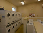 View larger image of Laundry room with washer and dryers at DIAMOND GROVE RV CAMPGROUND image #8