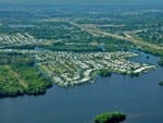 View larger image of Aerial view of homes with large body of water surrounding at ORANGE HARBOR CO-OP  RV RESORT image #7