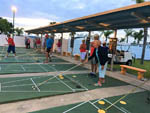 View larger image of Group of people playing shuffleboard at ORANGE HARBOR CO-OP  RV RESORT image #9