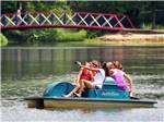 View larger image of Girls paddle boating on lake at CERALAND PARK  CAMPGROUND image #3