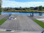 View larger image of Camping site with beautiful lake view at CANYON SPRINGS RV RESORT image #3
