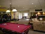View larger image of Exercise area and pool table in game room at the lodge at CANYON SPRINGS RV RESORT image #9