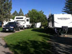 View larger image of RV and trailer parked at TRUCKEE RIVER RV PARK image #4