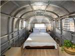 View larger image of Chair and table on deck next to Airstream at SHOOTING STAR RV RESORT image #12