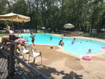 View larger image of Kids swimming in pool at JONESTOWN AOK CAMPGROUND image #3