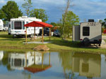 View larger image of Trailers camping near body of water at LITTLE TURTLE RV  STORAGE image #9