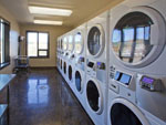 View larger image of Laundry room with washer and dryers at ANGEL FIRE RV RESORT image #9
