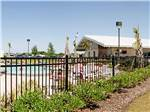 View larger image of Swimming pool  grassy area  at MONT BELVIEU RV RESORT image #1
