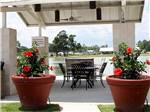 View larger image of Patio area with outdoor seating at MONT BELVIEU RV RESORT image #9