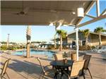 View larger image of Swimming pool with outdoor seating at FALLBROOK RV RESORT image #1