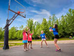 View larger image of Kids playing basketball at BEAR CREEK CAMPGROUND AT LAKE COMPOUNCE image #2
