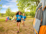 View larger image of Kids camping in tent at BEAR CREEK CAMPGROUND AT LAKE COMPOUNCE image #8