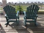 View larger image of Two green rocking chairs at GALVESTON ISLAND RV RESORT image #8