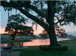 View larger image of Lake view at sunset at BRAZORIA LAKES RV RESORT image #2