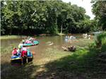 View larger image of People on rafts floating down the river at HIDDEN VALLEY FAMILY OUTFITTERS image #4