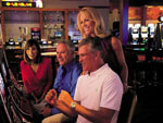 View larger image of Couples at casino at BRIGHTON RV RESORT image #3