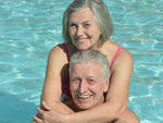 View larger image of Couple swimming at BRIGHTON RV RESORT image #5