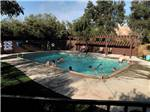 View larger image of People swimming in pool at LEMON COVE VILLAGE RV PARK image #5