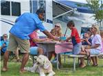 View larger image of Families camping at CHESAPEAKE BAY KOA  SUNSET BEACH HOTEL image #6